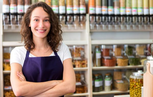 View of a Young attractive woman working at the grocery store